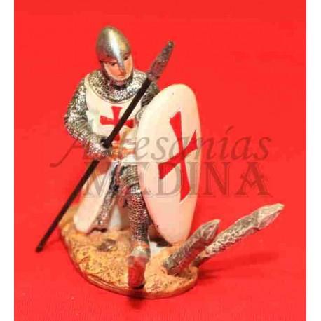 Guerrero con escudo de rodillas