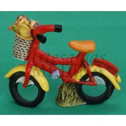 Figura bicicleta roja tradicional con cesta de flores